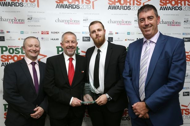 Winners of the Service to the Community award Nottingham Forest Community Trust, represented by Graham Moran and Callum Elliott (centre) pictured with category sponsor Dom Sweeney (left) and Darren Bicknell.